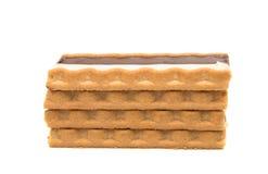 Biscoitos com enchimento do leite de chocolate fotos de stock