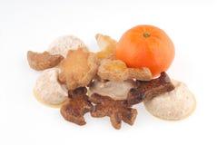 Biscoitos e laranja Fotografia de Stock Royalty Free