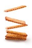 Biscoitos que flutuam o fundo branco isolado Imagens de Stock Royalty Free