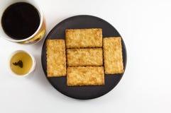 Biscoitos salgados com café e chá Imagem de Stock Royalty Free