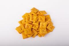 Biscoitos salgados do queijo no fundo branco Imagem de Stock Royalty Free