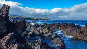 Biscoitos and volcanic rocs in Terceira, azores in wide angle. Wide angle of volcanic coast in Biscoitos, Terceira, Azores, Portugal stock photos