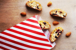 Biscotti with almond and dried cranberries in paper bag Royalty Free Stock Photography