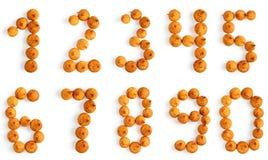 Biscotti appetitosi nei numeri di figura Immagine Stock