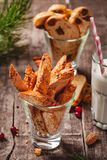 Biscotti or cantucci with milk on wooden rustic table. Christmas or New Year food concept. Biscotti or cantucci with milk on wooden rustic table. Close up stock photos