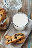 Biscotti or cantucci with raisins on wooden rustic table, traditional Italian biscuit Royalty Free Stock Photo