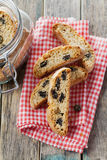Biscotti or cantucci with raisins on wooden rustic table, traditional Italian biscuit or cookie Royalty Free Stock Photos