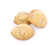 Biscotti casalinghi del sesamo su fondo bianco Immagine Stock