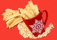 Biscotti in Christmas Mug Royalty Free Stock Image