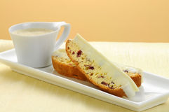Biscotti and Coffee. Delicious cranberry and white chocolate biscotti and espresso royalty free stock image