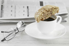 Biscotti with Coffee. Biscotti and coffee breakfast with the morning paper Royalty Free Stock Image