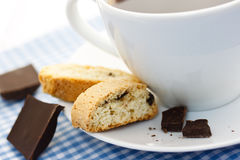Biscotti with coffee. Biscotti and chocolate with a cup of coffee on gingham tablecloth royalty free stock image