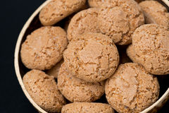 Biscotti cookies in a bowl on a black background, close-up Royalty Free Stock Image