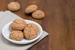 Biscotti cookies in a bowl on a wooden table and space for text Royalty Free Stock Images