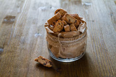 Biscotti cookies in glass jar, wood background Royalty Free Stock Photos