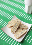 Biscotti cookies on plate with mug Royalty Free Stock Image