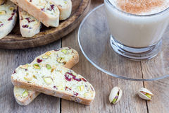 Biscotti with cranberry and pistachio, cup of coffee latte Royalty Free Stock Photos