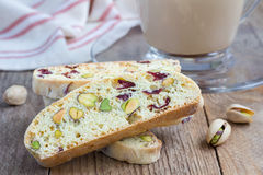 Biscotti with cranberry and pistachio with cup of coffee latte Stock Photos