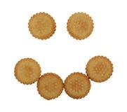 Biscotti crema Smiley Face della banana Fotografie Stock
