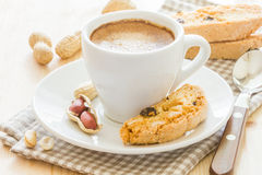 Biscotti. Cup of coffee and biscotti with peanut and raisins royalty free stock photography