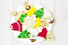 Biscotti decorati con un tema di Natale Fotografie Stock