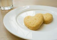 Biscotti del cuore per il biglietto di S. Valentino Immagini Stock