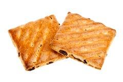 Biscotti del grano intero con frutta isolata Fotografie Stock