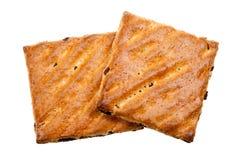 Biscotti del grano intero con frutta isolata Immagine Stock