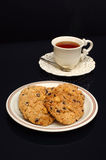 Biscotti del gruppo in zolla con tè Immagine Stock