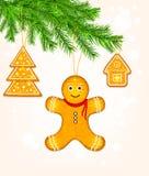 Biscotti del pan di zenzero sull'albero di Natale Fotografia Stock