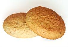 Biscotti dell'avena su priorità bassa bianca Immagini Stock