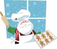 Biscotti di cottura di Santa Fotografia Stock Libera da Diritti