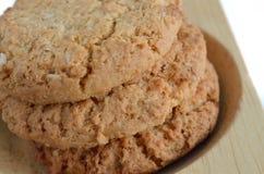 Biscotti di farina d'avena su legno Immagini Stock