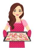Biscotti di forma del cuore di cottura della donna illustrazione vettoriale