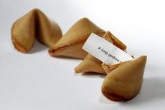 Biscotti di fortuna con il messaggio Fotografie Stock
