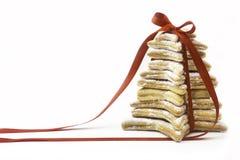 Biscotti di Natale legati dal nastro rosso Fotografia Stock