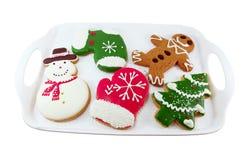 Biscotti di Natale; uomo della neve, albero di Natale, uomo del pane dello zenzero Immagine Stock