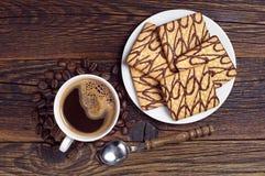 Biscotti e caffè del cioccolato Immagini Stock