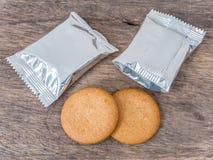 Biscotti e pacchetto della stagnola Fotografia Stock Libera da Diritti