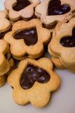 Biscotti - fiori con cioccolato Fotografia Stock
