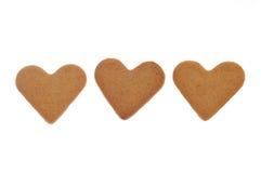 Biscotti a forma di della cannella del cuore Immagine Stock