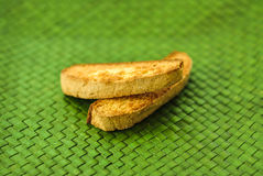Biscotti. Fresh baked biscotti on a green plate Royalty Free Stock Image