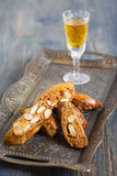 Biscotti and a glass of liquor. Stock Photo