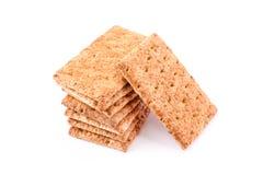 Biscotti sani con cereale su bianco. Immagine Stock Libera da Diritti