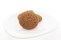 Biscotti su un piatto bianco Immagine Stock