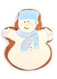 Biscotto dell'uomo di pan di zenzero del pupazzo di neve di festa sopra bianco Immagini Stock