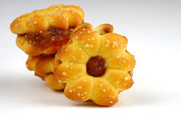 Biscotto della noce di cocco con l'inceppamento dell'ananas Fotografia Stock