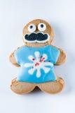 Biscotto divertente del pan di zenzero su un fondo bianco Fotografia Stock