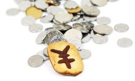 Biscotto e monete Immagine Stock