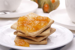 Biscuit with apricot jam. On the plate Royalty Free Stock Photo